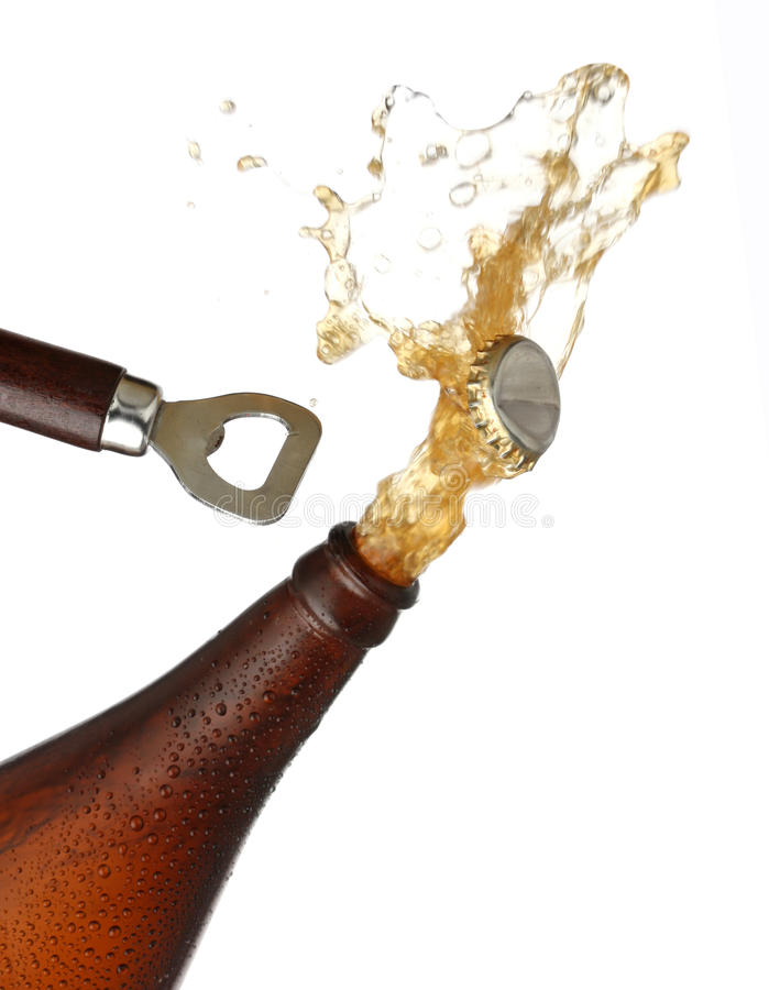 Opening a bottle of cold beer, splash image. White background stock photo