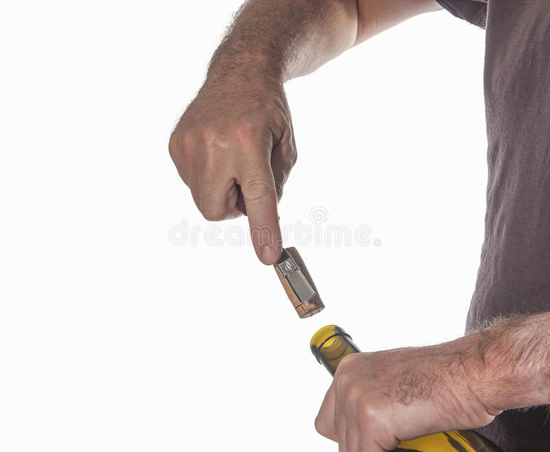 Opening a bottle stock images
