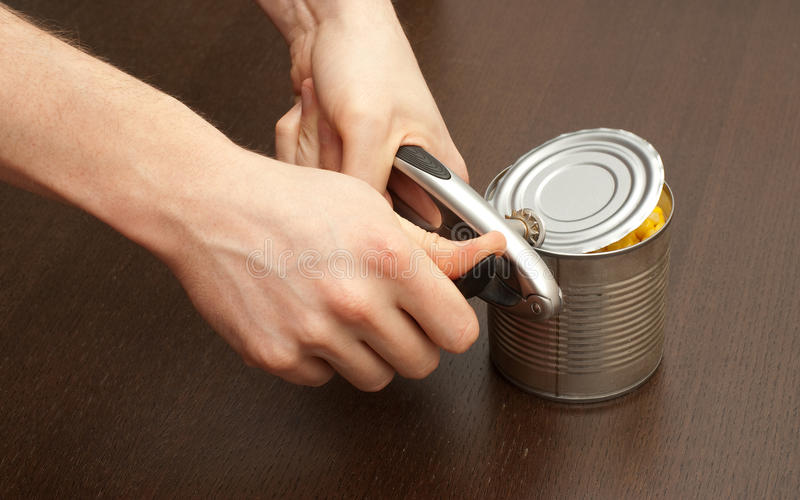 Opening the can stock photo