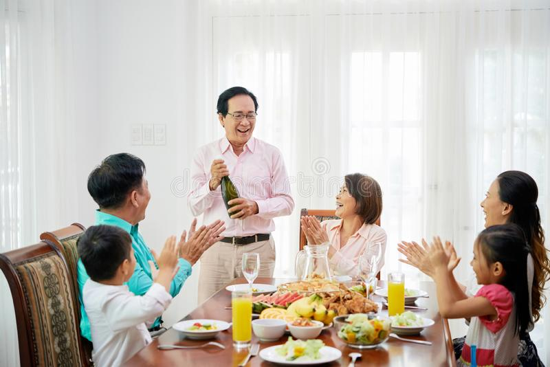 Opening champagne bottle royalty free stock photography