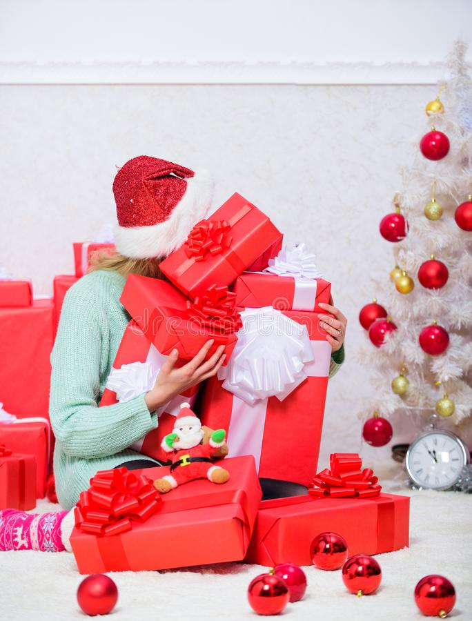 Opening christmas gift. Girl near christmas tree happy celebrate holiday. Santa bring her gift that she always wanted. Woman excited blonde hold gift box with royalty free stock photos