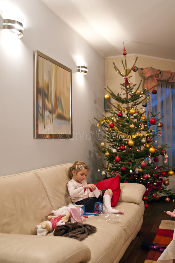Opening Christmas presents stock photography