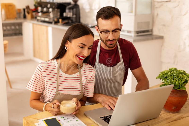 Couple feeling excited before opening coffeehouse royalty free stock images