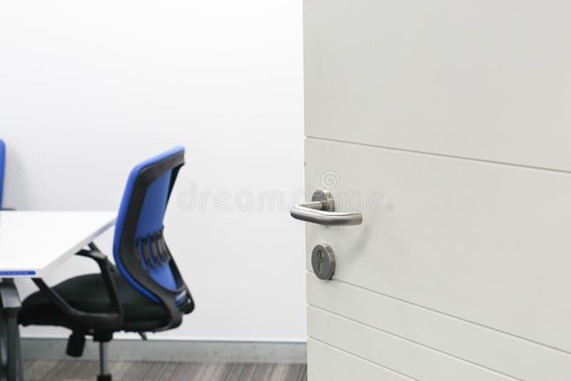 Opening the door of meeting room. Close up opening the door of meeting room royalty free stock photo