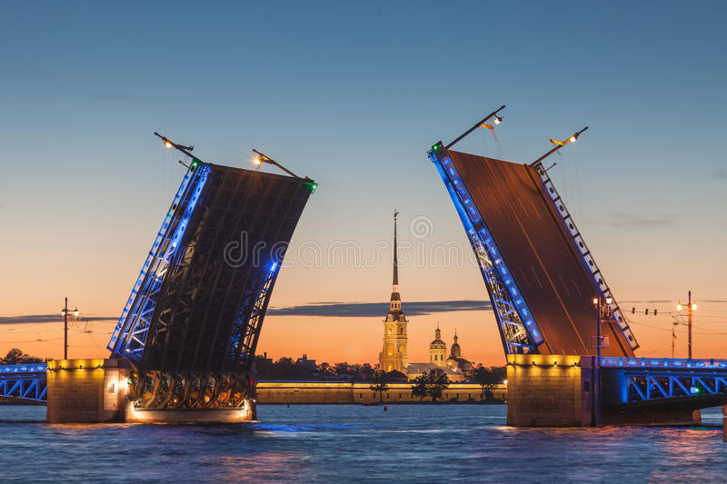 The opening of the drawbridge, white nights in Saint-Petersburg. White nights in Saint-Petersburg - the opening of the Palace drawbridge, a view of the Peter and royalty free stock images