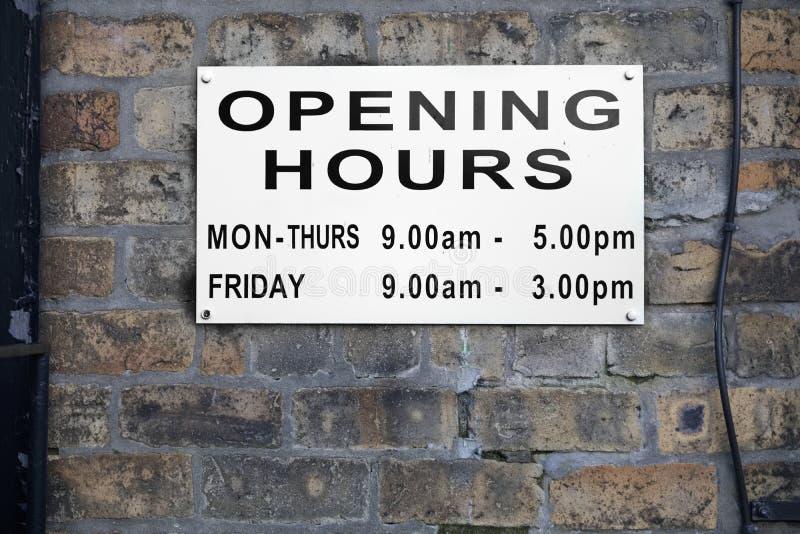 Opening hours shop sign Monday to Friday daytime. Uk stock images