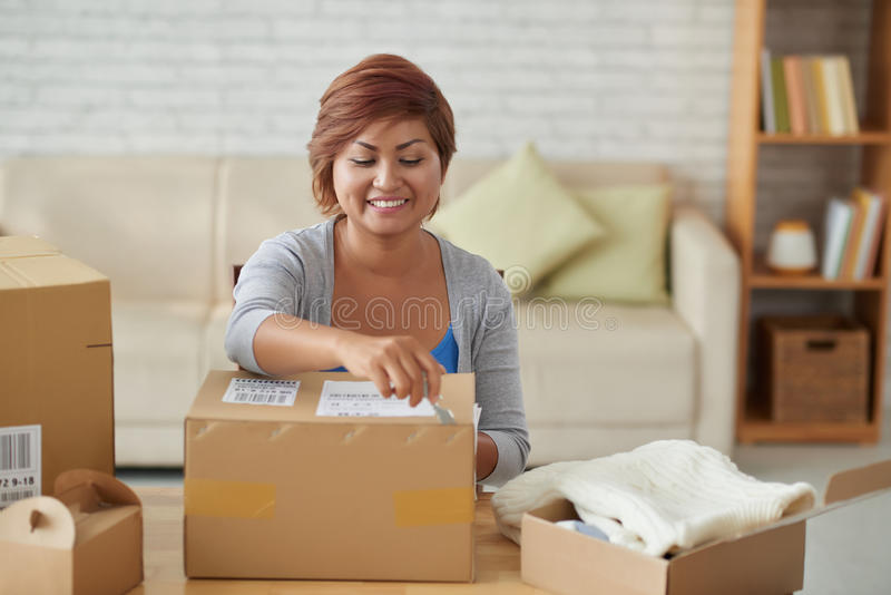 Opening parcels royalty free stock photos