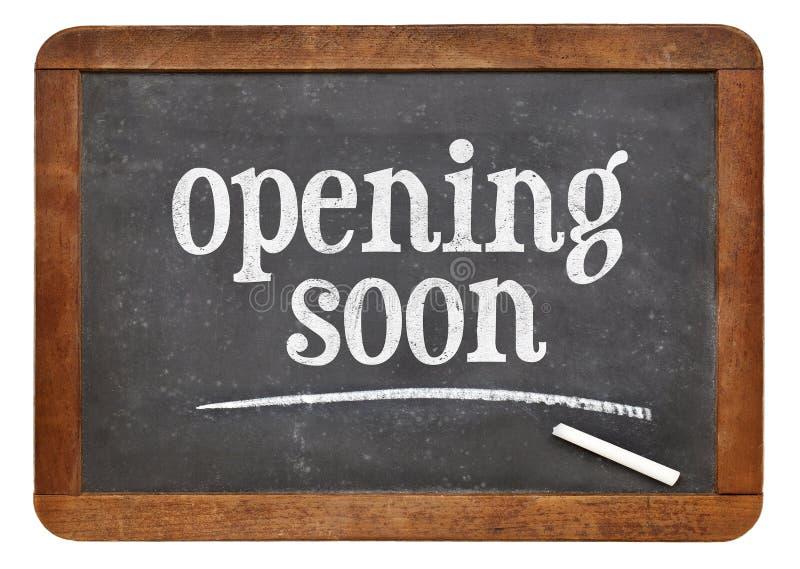 Opening soon blackboard sign stock photo