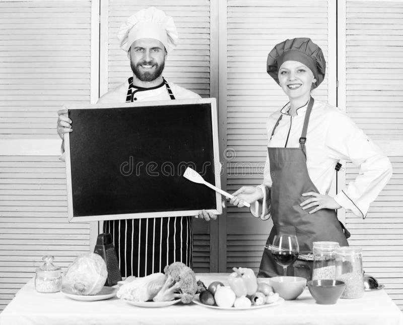 Opening soon. Hiring staff. Woman and man chef hold blackboard copy space. Job position. Cooking delicious meal recipe stock photos