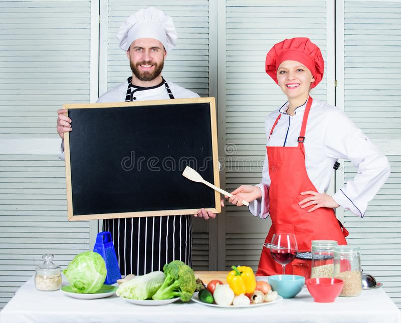 Opening soon. Hiring staff. Woman and man chef hold blackboard copy space. Job position. Cooking delicious meal recipe royalty free stock photo