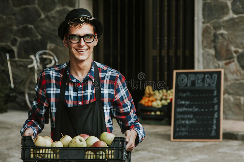 Opening store shop. Young man in his tent with blackboard advertising royalty free stock photography