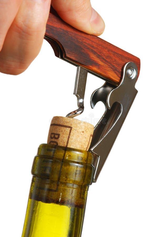 Opening a wine bottle stock image