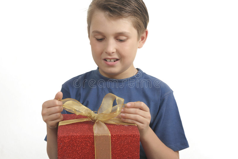 Download Opening Or Wrapping A Present Stock Photo - Image: 340610