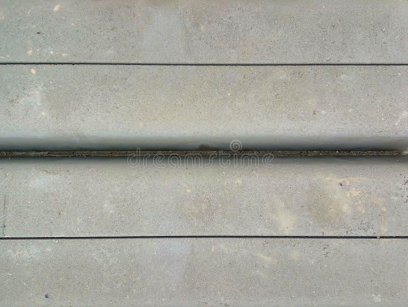 Openluchtgrunge poetste concrete textuur op stock fotografie