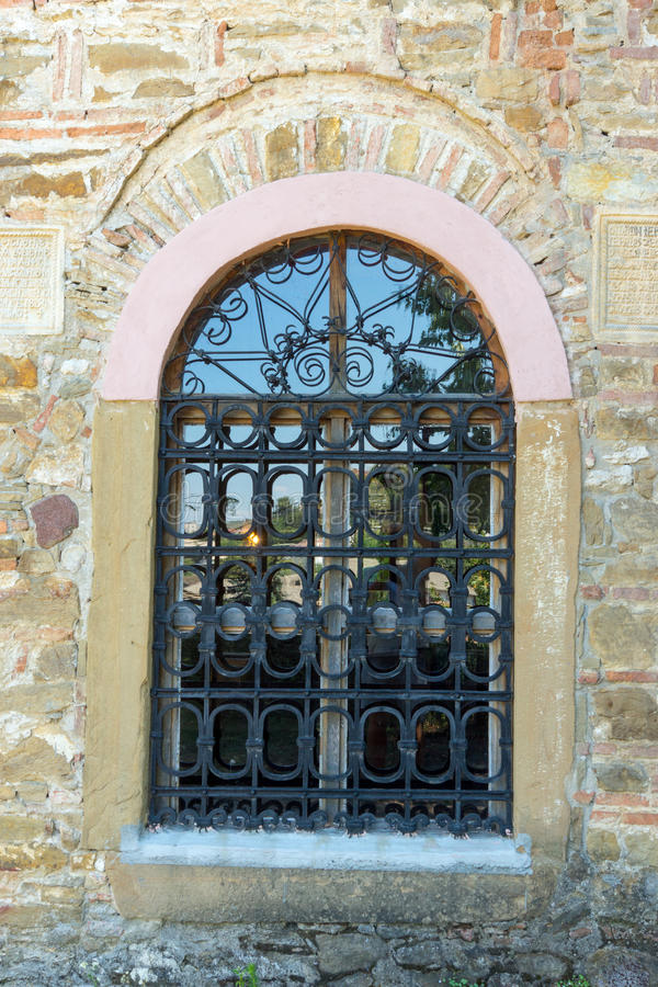 Openwork grille on the window of an old church in Lovech, Bulgaria stock photos