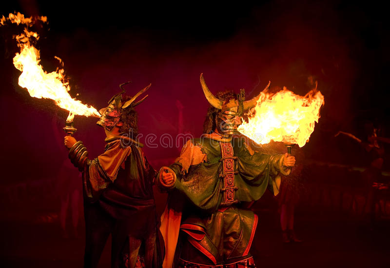 Opera actor spout flame. Is a skill of china opera stock photo