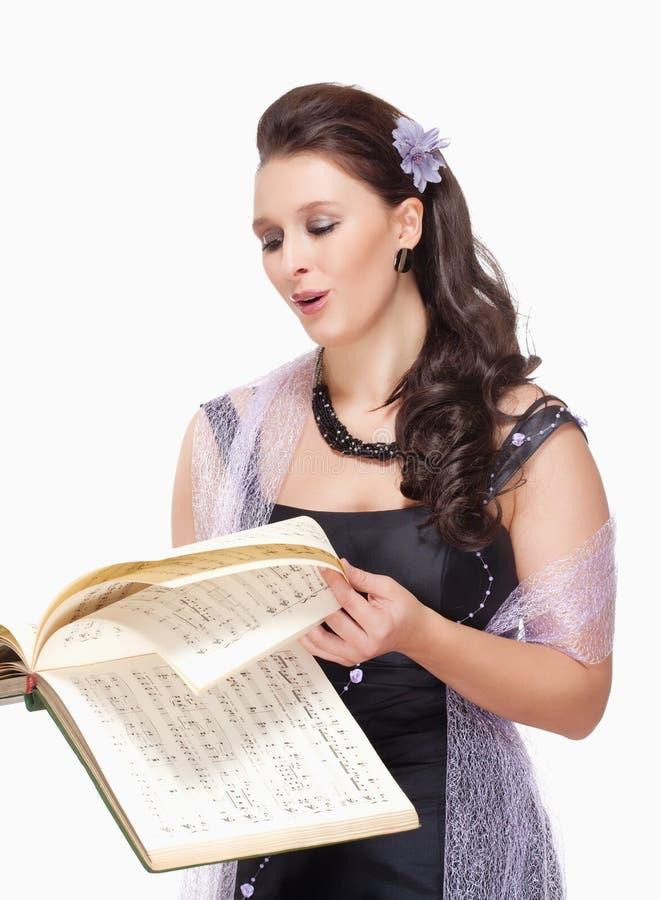 Opera Cantante Singing in suo vestito dalla fase immagine stock