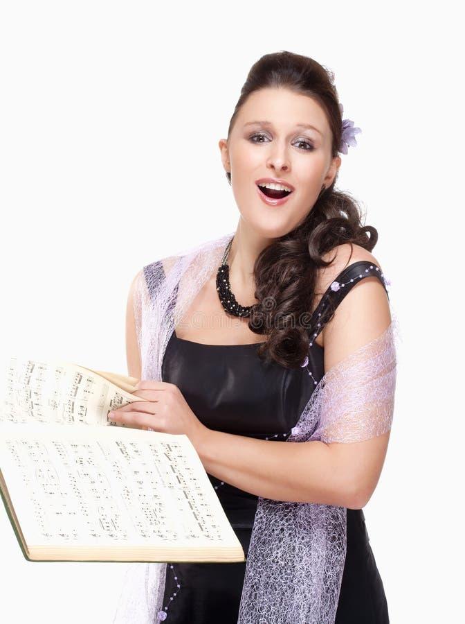 Opera Cantante Singing in suo vestito dalla fase fotografia stock libera da diritti