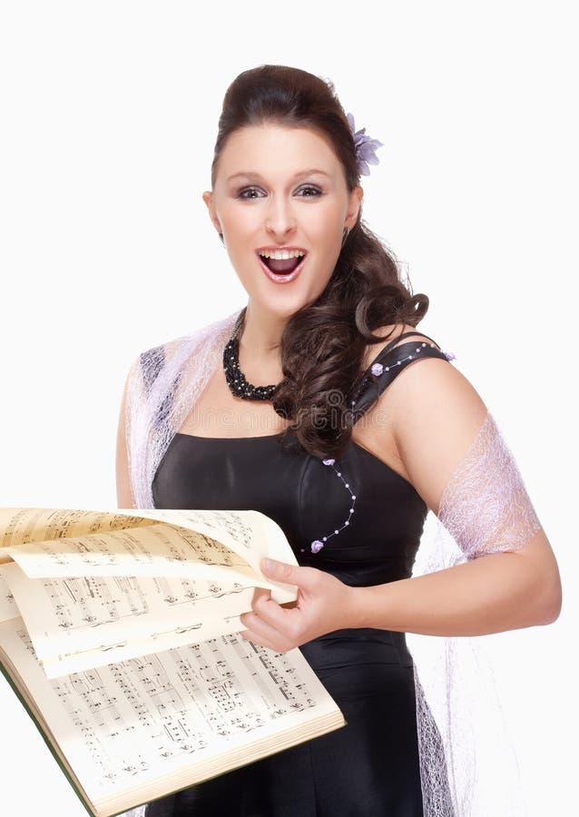 Opera Cantante Singing in suo vestito dalla fase fotografie stock