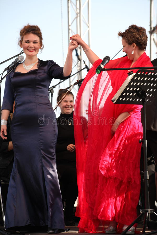 Opera duo - singer Alina Shakirova, russia, mezzo soprano, and Daniela Schillaci, la scala, italy, soprano, on the open stage stock photography
