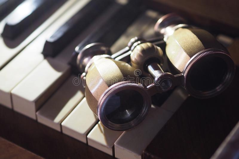 Opera glasses on the piano stock photo