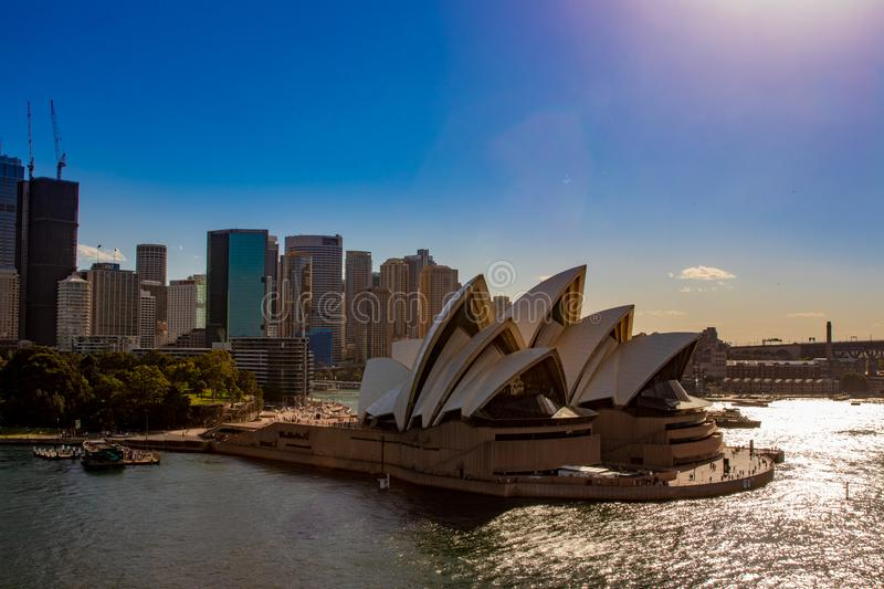 Opera House in Sydney, Australia, with the skyline in the back and a wonderful clear blue sky stock image
