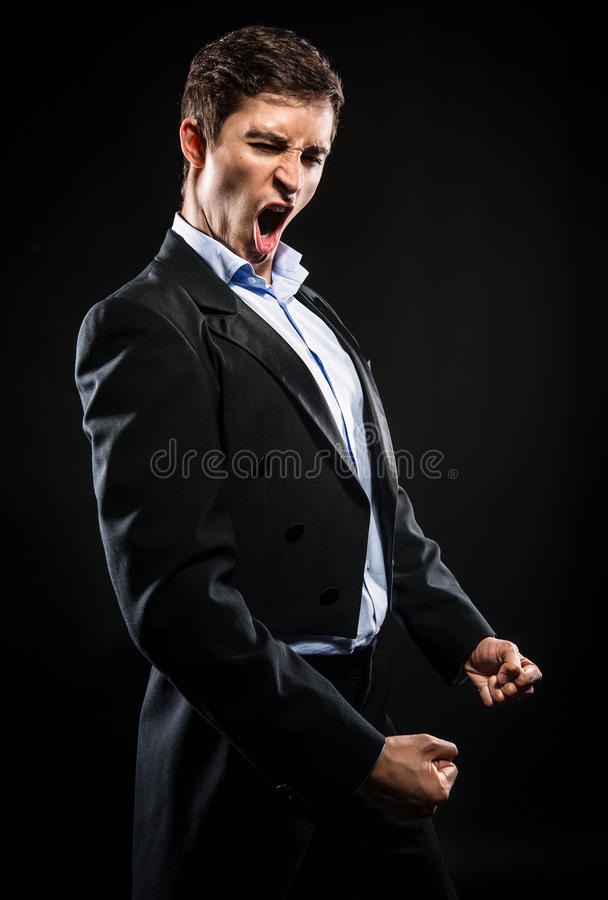 Opera singer. Performing over black background royalty free stock photo