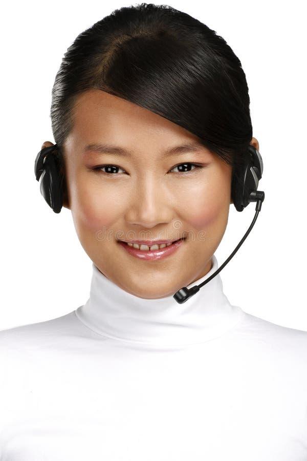Operador asiático de sexo femenino sonriente feliz del servicio de atención al cliente fotografía de archivo