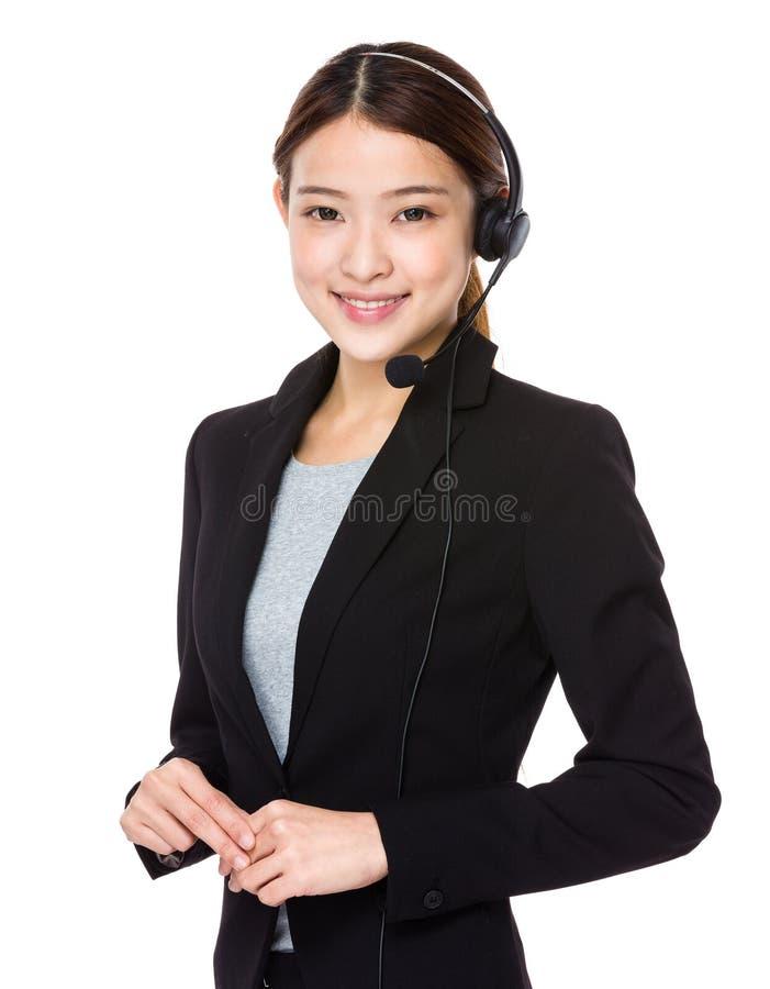 Operador bonito do centro de chamadas com auriculares imagens de stock royalty free