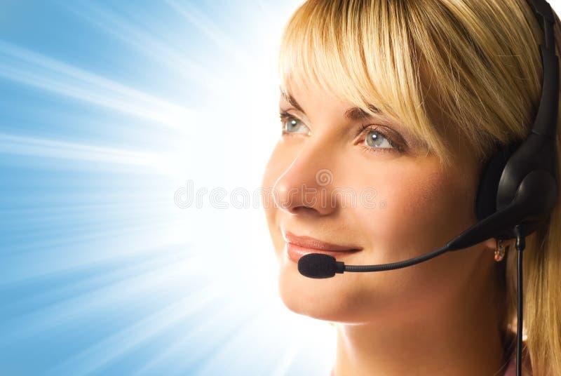 Operador cómodo del teléfono directo fotos de archivo