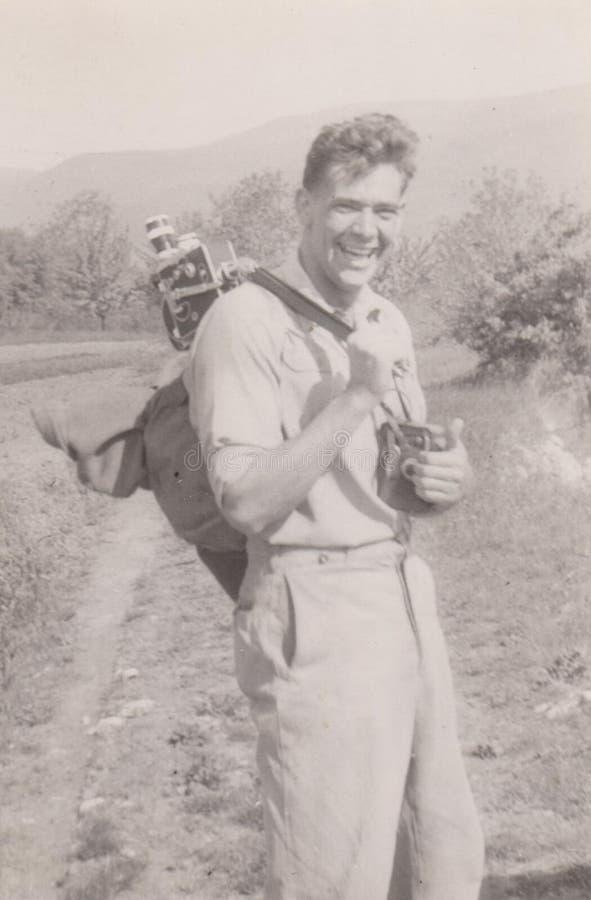Operador cinematográfico 1950-60 - caminhante do ` s de DT00034 HUNGRIA Ca com câmera fotos de stock royalty free