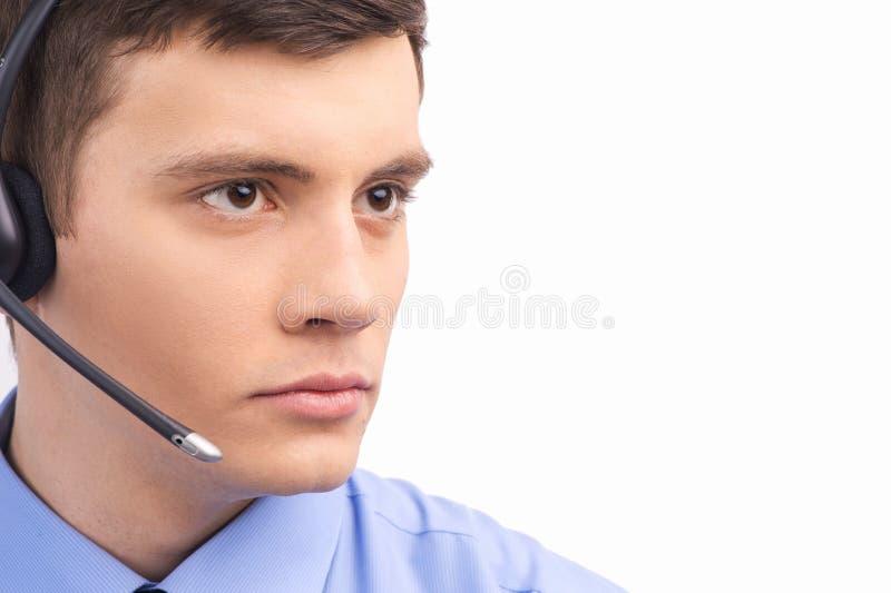 Operador considerável do suporte laboral que trabalha no branco fotografia de stock