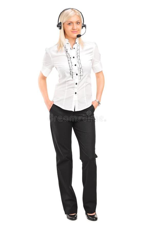 Operador de sexo femenino del servicio de atención al cliente con los auriculares foto de archivo libre de regalías