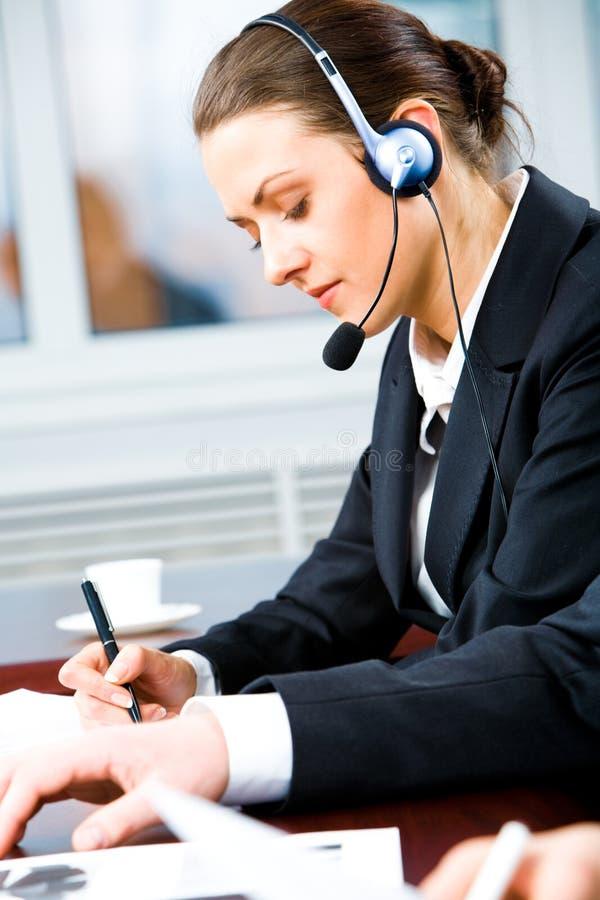 Operador de telefone ocupado foto de stock