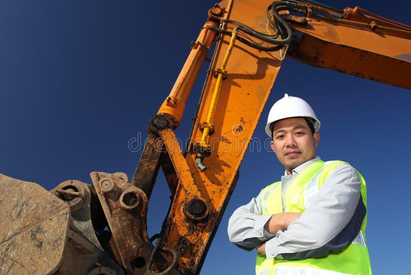 Operador de uma máquina escavadora fotos de stock