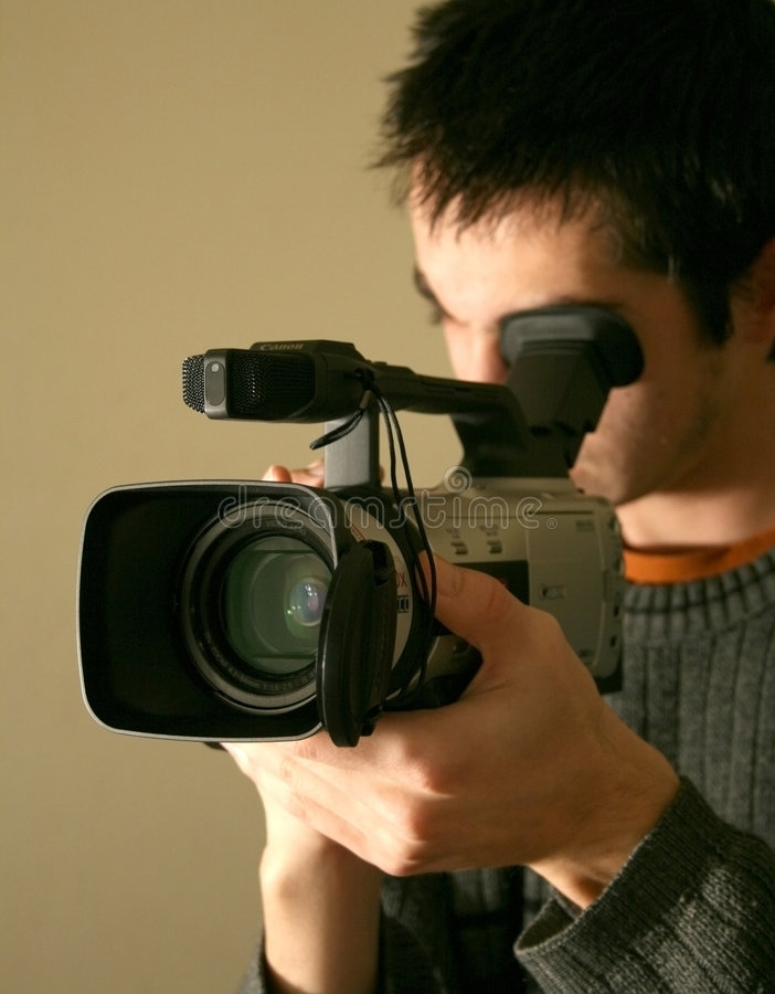 Operador do man_camera da câmera fotos de stock royalty free