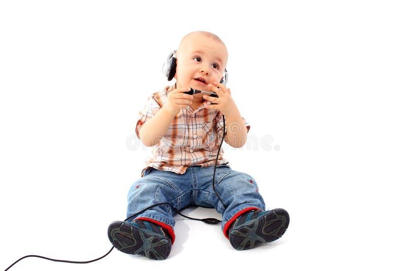 Operador feliz del teléfono de la ayuda del bebé en receptor de cabeza foto de archivo