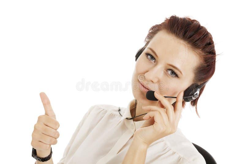 Operador sonriente del centro de atención telefónica con las auriculares del teléfono imagen de archivo libre de regalías