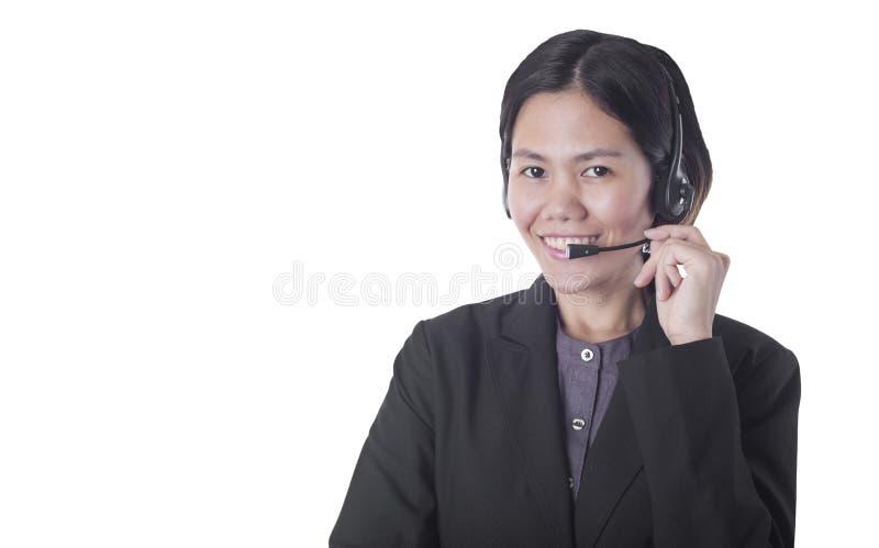 Operador sonriente feliz de la atención al cliente de las mujeres de Asia con las auriculares imagen de archivo