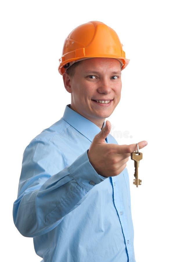 Operaio di costruzione con i tasti fotografia stock