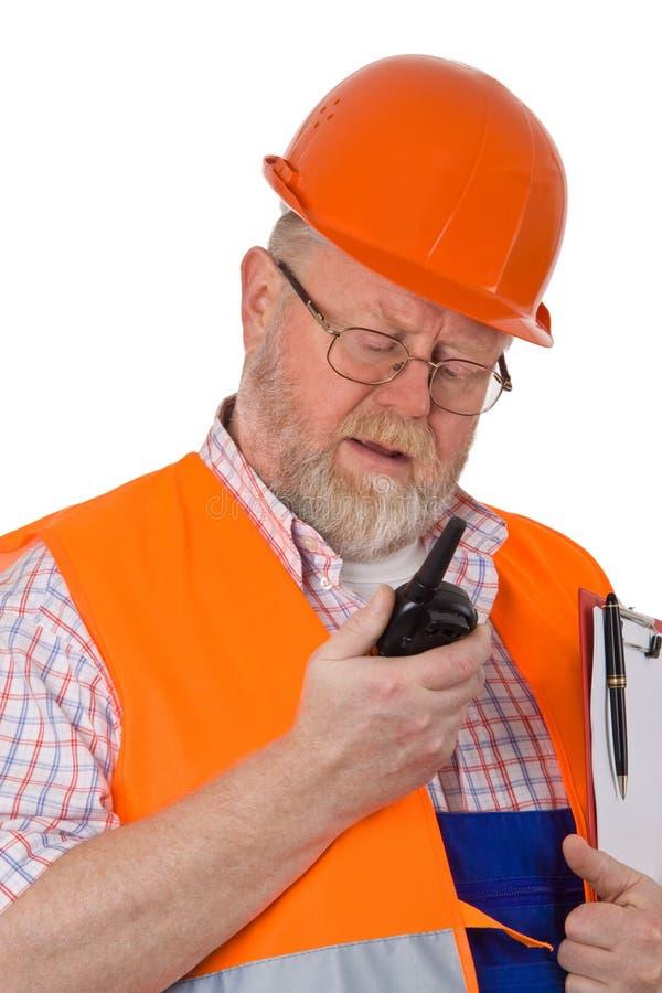 Operaio di costruzione con il walkie-talkie immagini stock libere da diritti