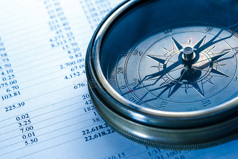 Operating budget and vintage compass stock photography