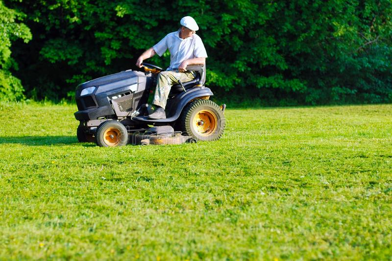 Operating professional grass mowing machine royalty free stock photography