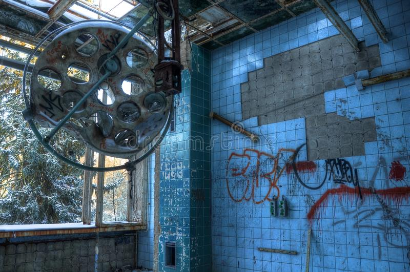 Operating theater in an abandoned hospital in Beelitz. Broken operating theater in an old sanatorium stock photo
