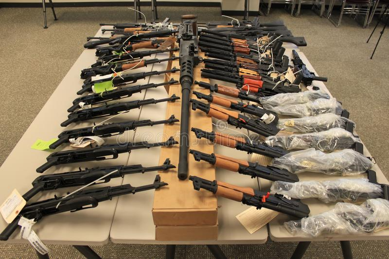 Operation fast and furious 3986. Phoenix, Ariz. / US - January 25, 2011: Guns, handguns, AK-47s and .50 caliber rifles, on display during an announcement about stock image