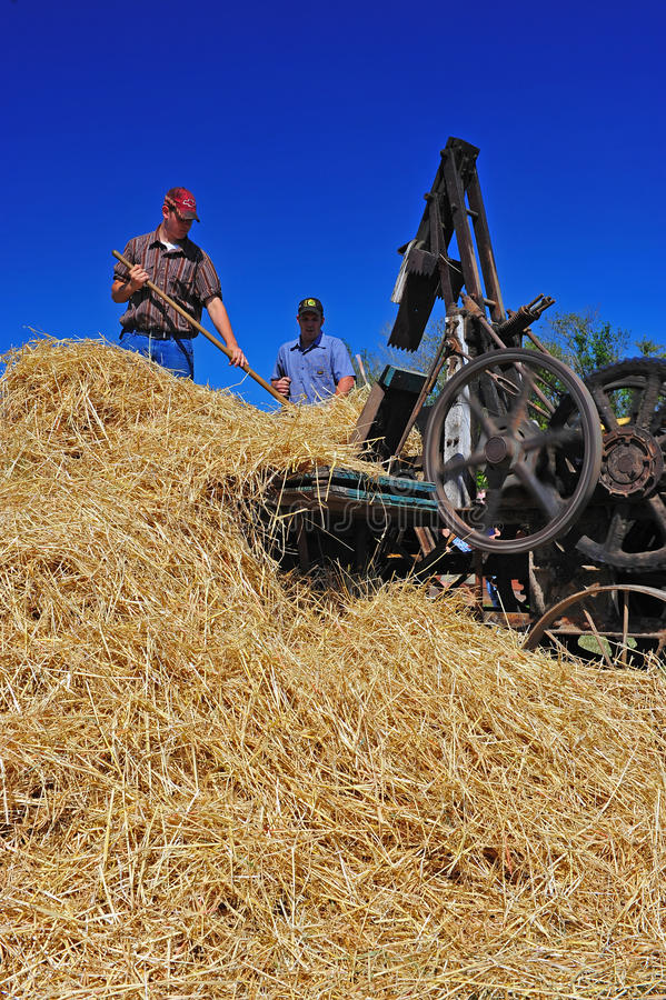 Operational 1918 Hay Bailer. July 30, 2011 Great Oregon Steam Up held in Brooks Oregon at the Antique Powerland museum. This photo captures the blue of the wheel royalty free stock images