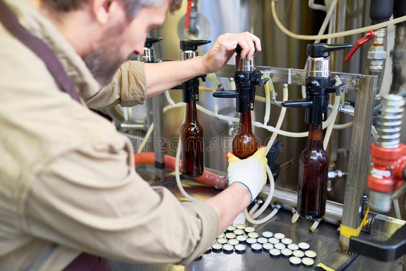 Operator of Beer Bottling Equipment royalty free stock photo