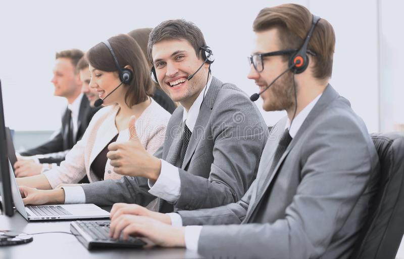 Employee call center with headset showing thumb up. Operator call center with headset showing thumb up royalty free stock images