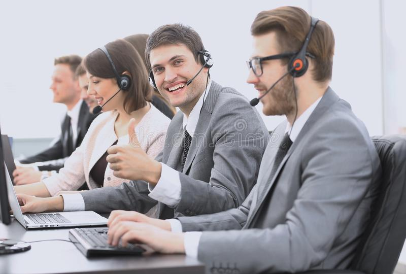 Employee call center with headset showing thumb up. Operator call center with headset showing thumb up royalty free stock photography
