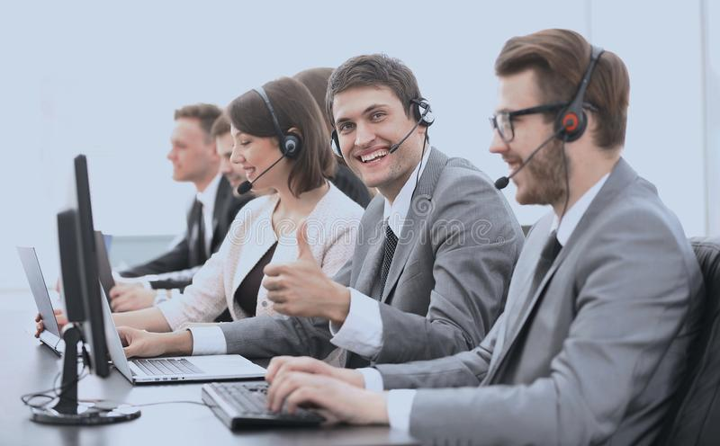 Employee call center with headset showing thumb up. Operator call center with headset showing thumb up royalty free stock photos